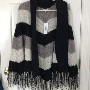 Striped sweater cape never been worn. So cozy!